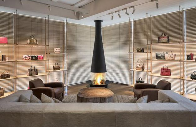 Central design fireplace Filiofocus in a showroom Louis Vitton