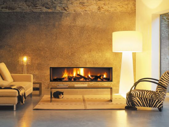 Discover the range of stoves and fireplaces Focus design insert. Recessed fireplace in the wall for optimal performance.